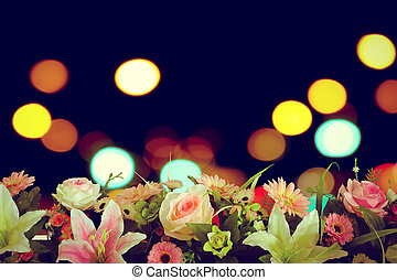artificial florist with blur bokeh from traffic light background
