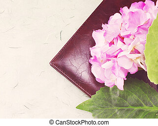 artificial flower on notebook cover with vintage filter effect retro style