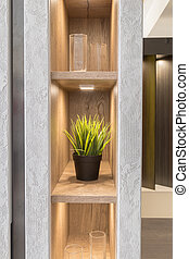 Artificial flower on the shelf in the closet with a new design and lighting.