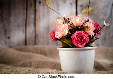 Artificial flowers and white pot - Vintage tone color of...