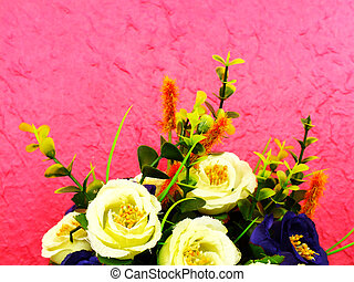 artificial flowers bouquet on pink background