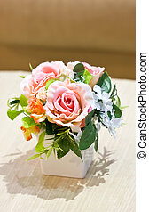 Artificial flowers in vase.