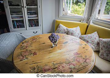 Artificial flowers on the dining room table