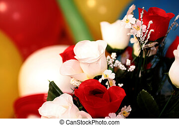 artificial flowers over balloons