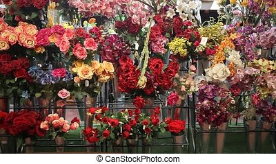 artificial flowers prepared for sale on display in shop. High quality FullHD footage