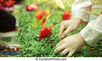 Artificial flowers - Children plant artificial flowers
