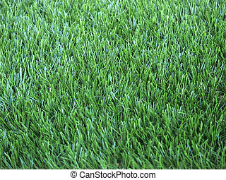 Close up view of green artificial grass turf background