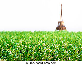 Artificial grass with blurry background of Eiffel tower paper model apply for Euro 2016 football tournament at France