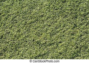 Artificial green grass shot from above, top-down.