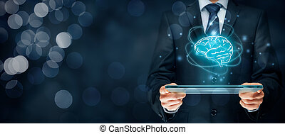 Artificial intelligence (AI), machine deep learning, data mining, expert system software, and another modern computer technologies concepts. Brain representing artificial intelligence and businessman holding futuristic tablet.