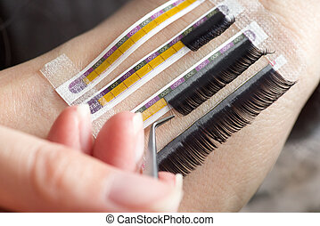 Artificial lashes. - Beautician making artificial lashes....