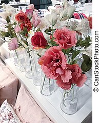 Artificial pink and white flowers in a vase