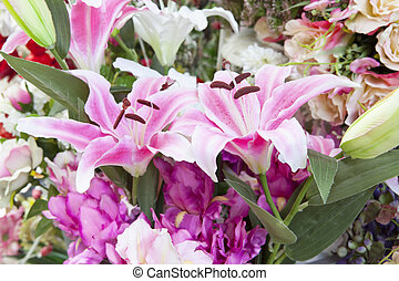 artificial pink lilly flowers bouquet arrangement for decorated and use as background backdrop