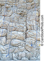 Artificial rock climbing wall background