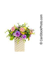 Artificial rose flowers in vase