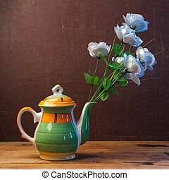 Artificial roses in a creative vase,