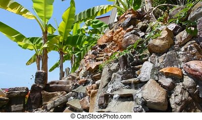 artificial stone cascades and palm on tourist territory near...