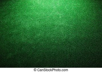 Artificial turf. Studio shot. Green background. Copy space....