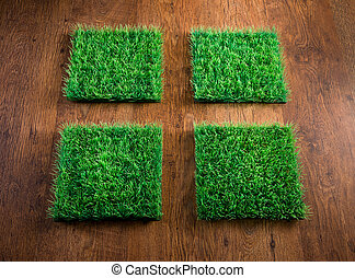 Artificial turf tiles - Four artificial turf tiles on...