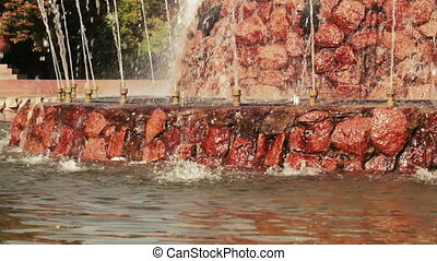 Artificial waterfall in park - Water flows down the chute...