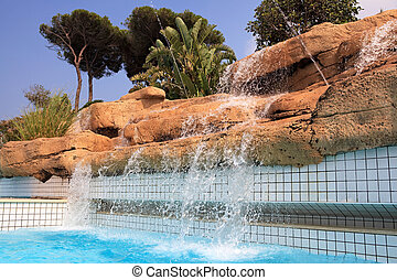 Artificial waterfall in the pool.