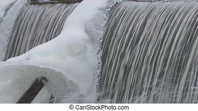 artificial waterfall in winter.
