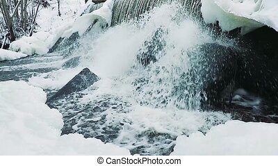 artificial waterfall in winter in slow motion.