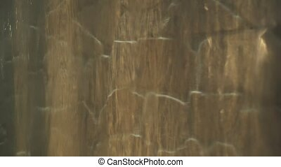 Artificial waterfall on the background of stone wall stock footage video