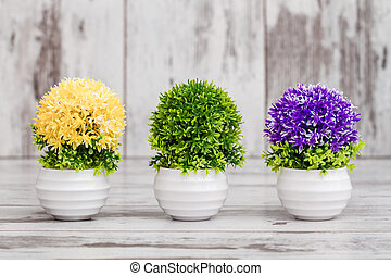 Artificial Yellow, Purple and Green Plants in a Flowerpot