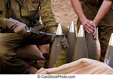 NACHAL OZ , ISR - DEC 30:Israeli artillery soldiers prepare shells to be fired on Dec 30 2005.The IDF artillery corp using advanced technology to improve its precision and effectiveness