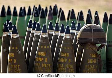 NACHAL OZ , ISR - MAY 30:Israeli artillery soldier helmet on live shells ready to be fired on May 30 2005.The IDF artillery corp using advanced technology to improve its precision and effectiveness