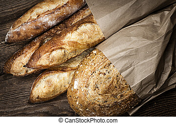 Artisan bread - Fresh baked rustic bread loaves in paper...