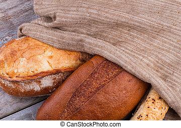 Artisan bread in burlap bag.
