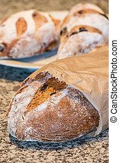 artisan bread in paper bag