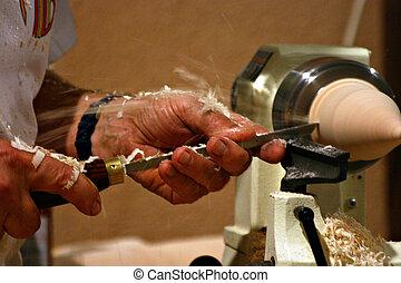Artisan carving wood - An artisan is carving wood...