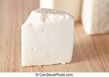 artisan cheese on natural wood base