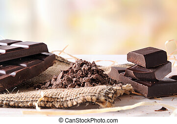 Artisan chocolate broken tablet stack with portions and...