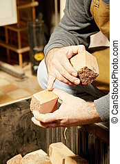 Artisan hands with wood billets