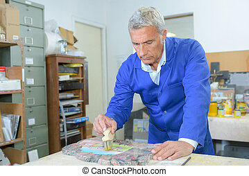 artisan in workshop