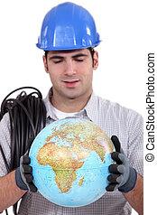 Artisan looking at globe