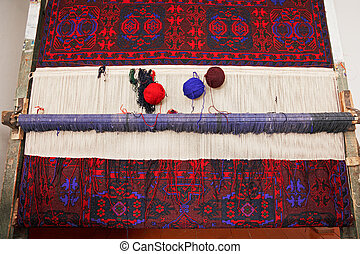 Artisan loom with handmade carpet