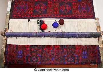 Artisan loom with handmade carpet