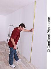 artisan measuring wall