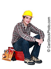 Artisan sitting on toolbox