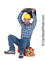 Artisan with computer sitting on top of the head