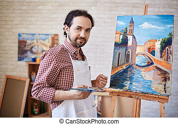 Artist and his masterpiece - Young artist looking at camera ...
