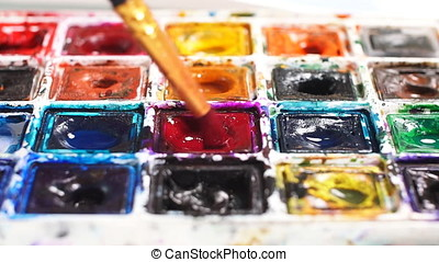 Artist brush mix color oil painting on palette close up