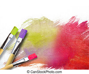 Artist brushes with a half finished painted color canvas