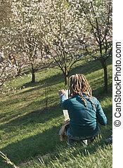 Artist creating landscape