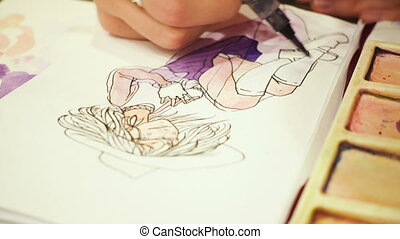 artist drawing a sketch with the watercolors paints